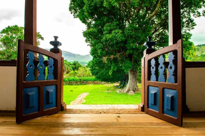 opened brown wooden gate